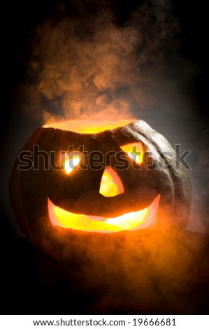 old pumpkin head on a black background - stock photo
