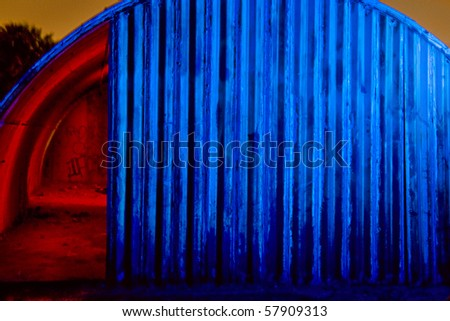 Old Quonset Hut in Red & Blue - stock photo
