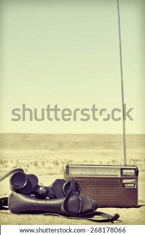 Old radio and  binoculars vintage, retro style - stock photo