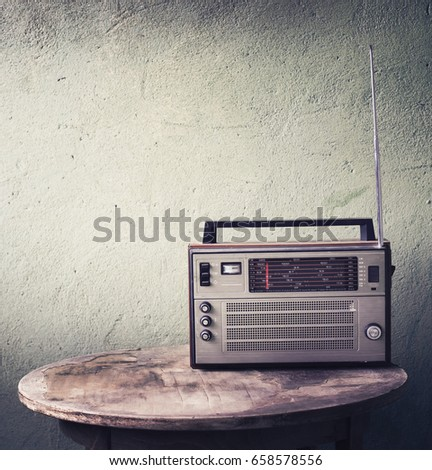 Old radio on rustic background in vintage color