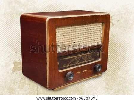 Old radio tuner  on grunge background - stock photo