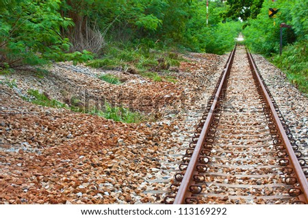 old rail in the middle of the forest. - stock photo