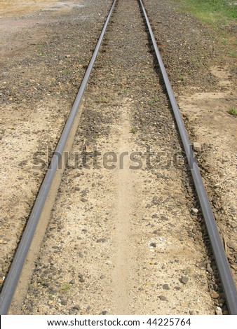 Old rail road tracks. Vertically framed shot. - stock photo