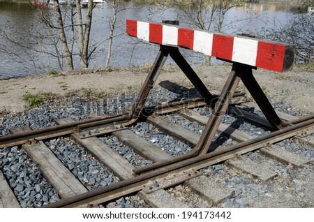 old railway siding on the lake shore - stock photo