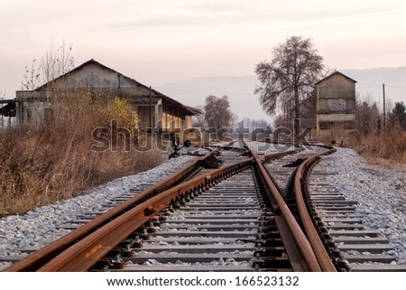 Old railway station and tracks, in Florina, northern Greece, in autumn - stock photo