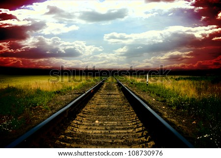 Old railway to storm sky with clouds