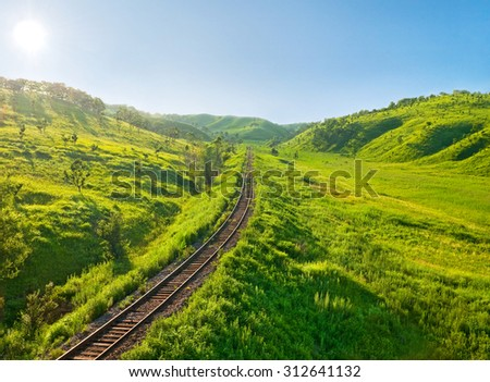 old railway track on the morning hills landscape  - stock photo