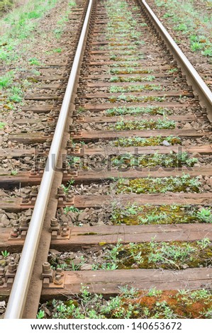 Old railways with green vegetation