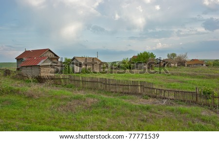 old ranch on a green field