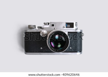 Old rangefinder vintage camera on white background - stock photo