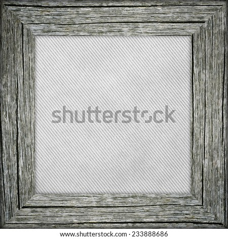 Old raw wooden frame with grey striped canvas - stock photo