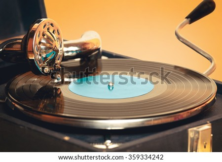 Old record player gramophone needle on record closeup. vintage toning - stock photo
