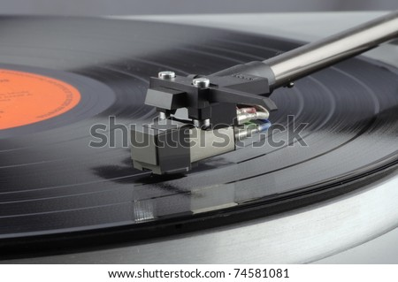Old record player with LP - stock photo