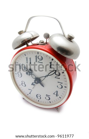Old red alarm clock on a white background