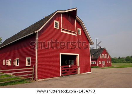 Old red barn and out building on a very old farm - stock photo