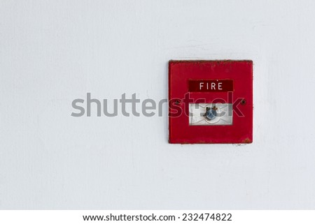 Old red box fire alarm  on wall