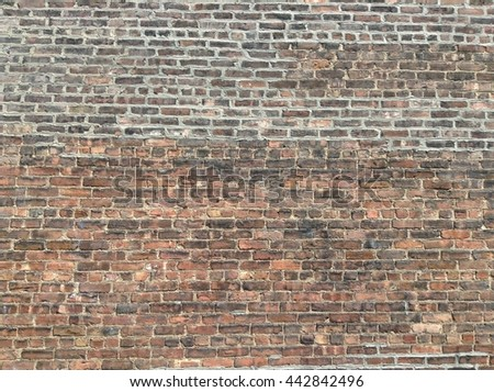 Old red brick blocks wall with door was bricked off