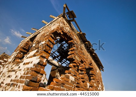 old red brick building falling apart - stock photo