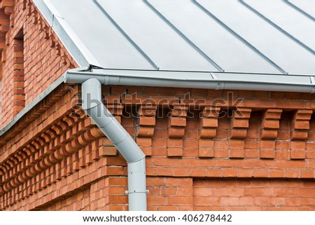 old red brick house with gutter and downspout - stock photo