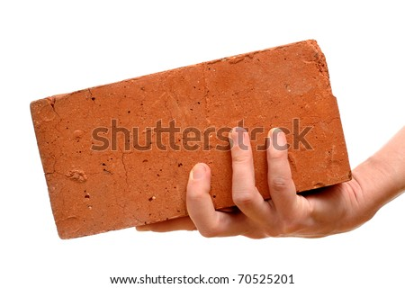 Old red brick in hand isolated on white background - stock photo