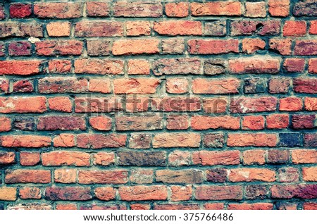 Old red brick wall textures and backgrounds - stock photo