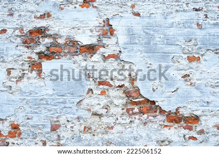 old red brick wall with white painting - stock photo