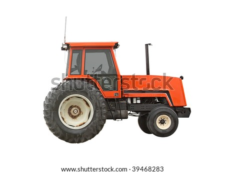 Old red farm tractor isolated on white - stock photo