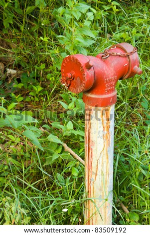 Old red fire hydrant in rural of Thailand - stock photo