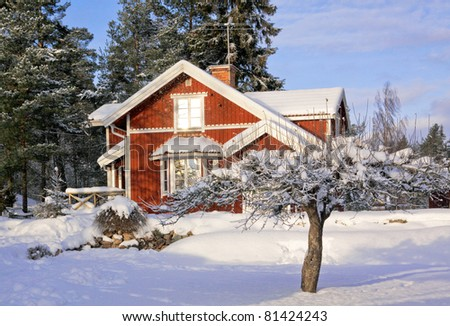 Old red house in the wintertime. - stock photo