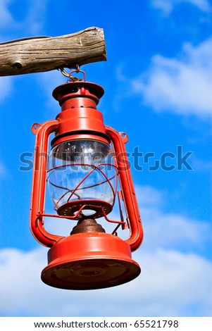 Old red lantern on blue sky - stock photo