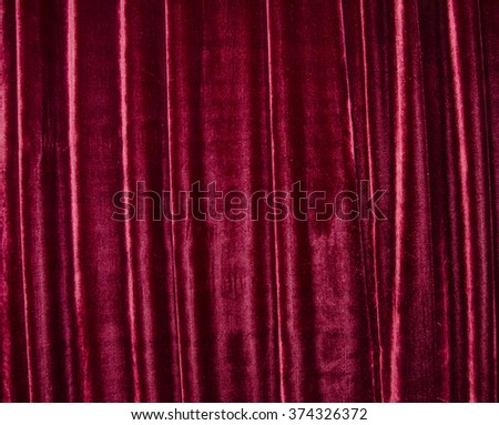 Old red stage curtain (as a drapery background) - stock photo