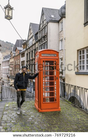 Old red telephone box at the center of the village Cochem Germany December 2017