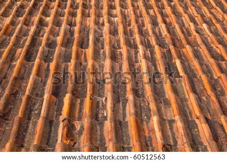 Old red tile roof. A background - stock photo
