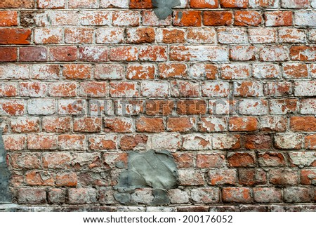 Old Red Wall with Bricklaying under White Cracked Paint - stock photo