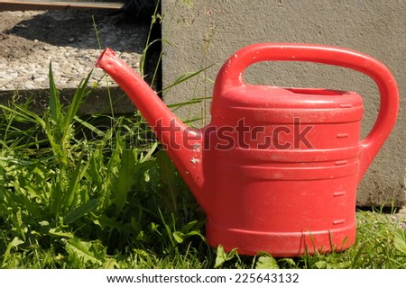 old red watering can - stock photo