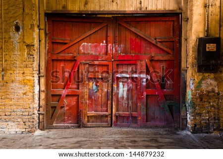 old red wood gate - stock photo