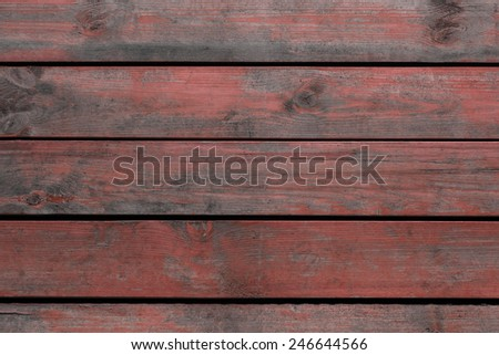 Old red wooden board for background - stock photo