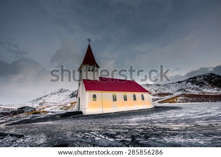 Old red wooden church, Vik, Iceland - stock photo