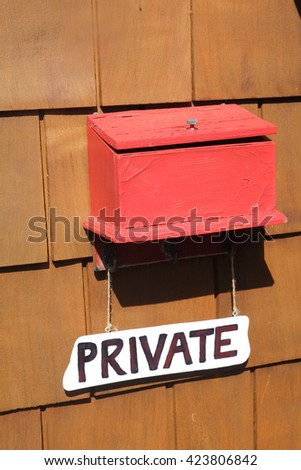 Old red wooden mail box on wooden wall in fisherman 's wharf Victoria ,BC,CANADA - stock photo