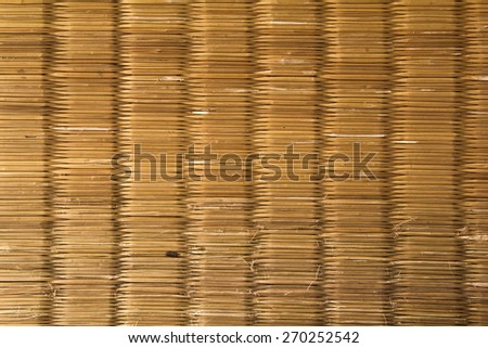 Old Reed mat texture. - stock photo