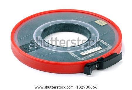 Old reel of  computer data tape isolated on white - stock photo