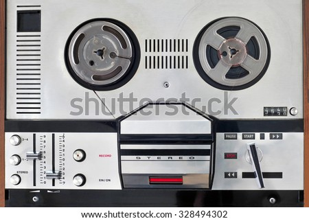 Old reel to reel tape recorder and player - stock photo