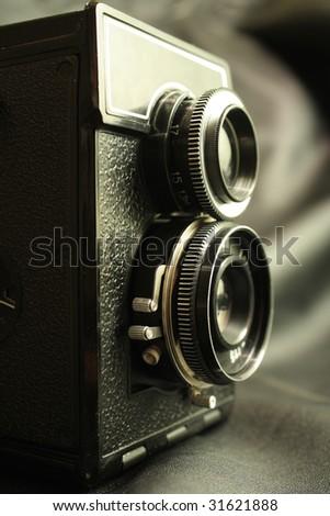 old reflex camera 120 format film - stock photo