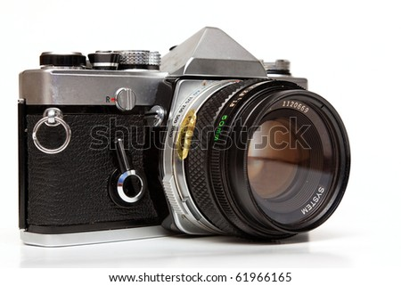 Old reflex camera on a white background. - stock photo
