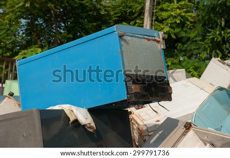 Old refrigerator that is broken or breaking the pile at the plant waste for recycling.