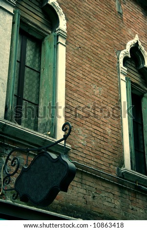 Old restaurant BLANK sign in Venice in a street - stock photo
