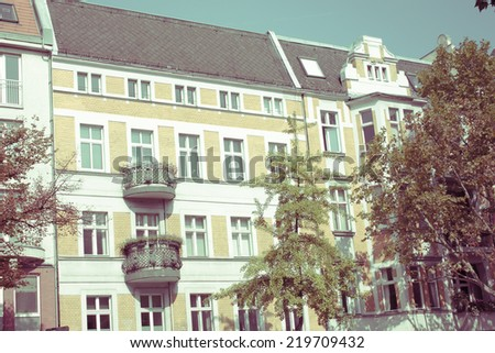 Old Restored Apartment House in Berlin, dating from the Gruenderzeit, The Founder Epoch , 19th Century, known as the Founding Epoch Architecture style with a retro vintage instagram filter effect - stock photo