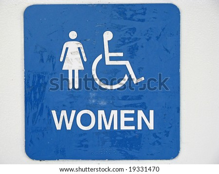 old restroom sign with women handicap characters