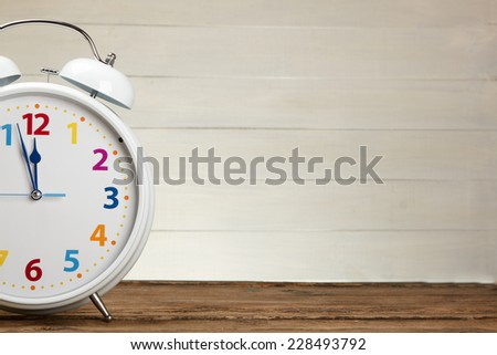 Old retro alarm clock on table  - stock photo