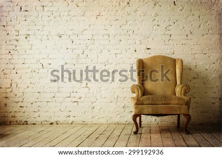 Old Retro Armchair against White Brick Wall Interior - stock photo